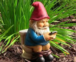 garden knomes. Exellent Knomes Reading Phone On The Throne Garden Gnome Throughout Knomes
