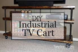 Iron and wood combining to make the perfect industrial tv cart/stand.