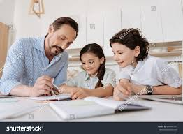 young father helping his children math stock photo  young father helping his children math assignments
