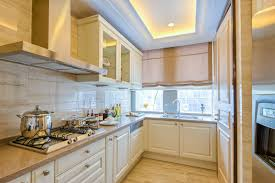 beige kitchen with ventilation hood over gas stove