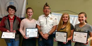 local vfw encourages patriotism in school  presents the winners of this year s essay contests l r the patriot s pen gavin shires first and callie miller second and the voice of democracy
