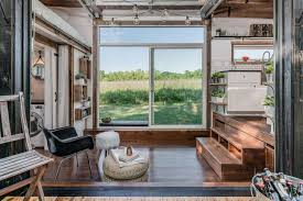home garage doorTricked Out Tiny Home Features Garage Door and Custom Deck  Curbed