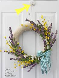this is a genius way to hang a wreath without damaging the door i love