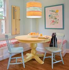 colorful dining rooms. Small Yet Comfy Dining Room With Yellow Round Table Corner Sofa Blue Wooden Chairs And Pendant Lamp Wall Color Image Colorful Rooms