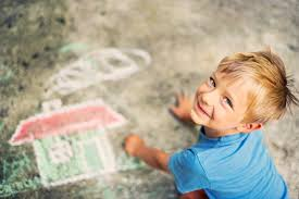 respite boy drawing sidewalk chalk