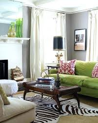faux zebra skin rug the eclectic mix of textures includes a faux fur ottoman and a faux zebra skin rug