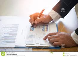 Business Man Analyzing Graph And Chart Document Report Stock