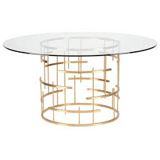 nuevo tiffany round glass top metal dining table in gold