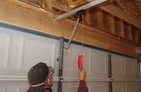 disene the opener from the garage door