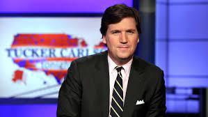 Fox News host Tucker Carlson takes his ...