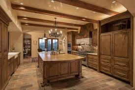rustic luxury kitchen with island and chandelier