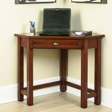 the typical of pine wood small dark brown wooden corner desk for small home office