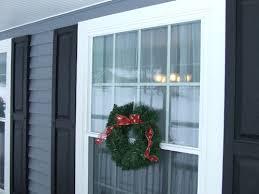 hanging wreaths on vinyl windows