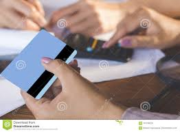 Two Business Woman Hand Counting On Calculator And Holding Credit