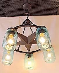5 light lone star chandelier in dark bronze finish with blue mason jar glass width 26 height 28 max watt 5 60w med base bulbs