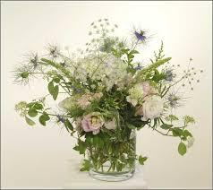 english garden flower arrangement seasonal flowers in glass vase