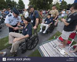 The U.S. Air Force Band director of operations Capt. Dustin Doyle greets a  WWII veteran before the start of the Star Spangled Spectacular at the Air  Force Memorial July 4, 2017, Washington,