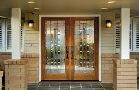 entryway with fir double front doors with glass