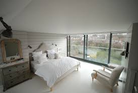 contemporary loft furniture. Contemporary Loft Conversion Bedroom With Full Width Sliding Glass Doors Furniture