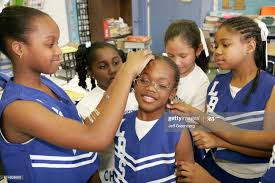 A group of cheerleaders fixing their hair at Lenora Smith Elementary...  News Photo - Getty Images
