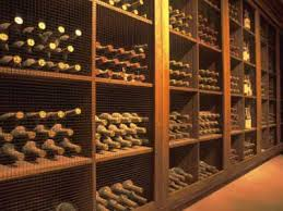 Wine cellar in Napa Valley with plenty of aging, dusty bottles. See more  wine