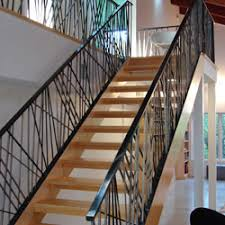 Kinetic Rail. Forged Baluster Bahamas Railing. Modern Arc Railing