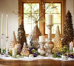 This tablescape gets it appropriate with varying heights of decorative  trees, candle holders and tiny