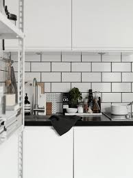 kitchen details white tiles black grout