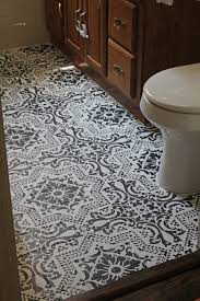 diy how to easily paint your tile floor for a budget friendly modern update black and white stencils i98 stencils