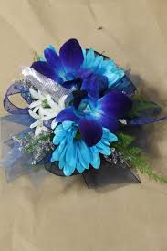blue dendro orchids blue daisies white hyacinths wrist corsage for prom or weddings