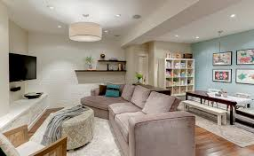 basement family room inspiration for a transitional single wall wet bar remodel in toronto with an basement bedroom lighting ideas
