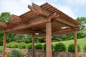 solid wood patio covers. Solid Brown Wooden Outdoor Pergola With Beveled Edges Roof Top Combine Piled Stone Wall Structure Wood Patio Covers