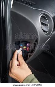 replacing the fuse in fuse box of the car stock photo, royalty How Do You Replace A Fuse In A Fuse Box replacing the fuse in fuse box of the car stock photo how to replace a fuse in a fuse box