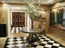 great half round foyer table in round entry table design with planter standding by paint wall and photo frame enlightened by ceiling lights