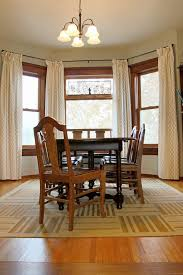 dashing square table fit to enthralling dining room rugs with wood chair under chandelier plus glass window closed nice curtain and wooden floor
