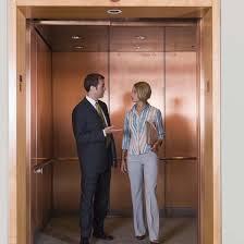 people standing in elevator. 86538827 people standing in elevator
