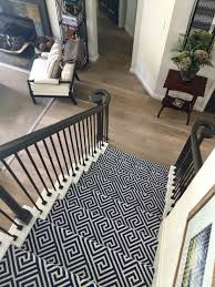 patterned stair carpet. Patterned Stair Carpet In Center Of Open Plan Home With Wood Bottom Step - Designer Carla S
