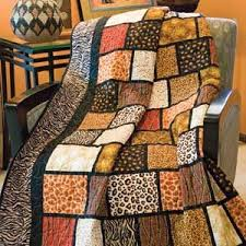 Best 25+ African quilts ideas on Pinterest   Quilt patterns ... & Into Africa: Quick Fat Quarter-Friendly Novelty Lap Quilt Pattern Designed  by COLLEEN REALE Adamdwight.com