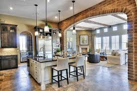 brick veneer flooring. The Veneer Is Applied To Large Archway Between Kitchen And Living Room, Providing Brick Flooring U