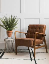 mid century on and stud brown leather armchair at rose grey