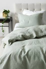 the pale green non textured bed linens