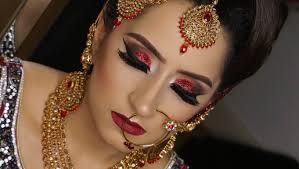real bride modern traditional asian bridal makeup red glittery smokey eyes