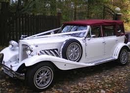 beauford hire birmingham vintage wedding car hire birmingham Wedding Cars Lichfield white beauford convertible 1934 wedding car wedding cars lichfield area