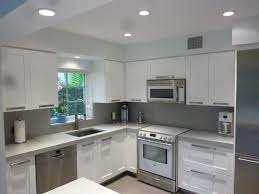 white shaker kitchen cabinets. Resurfacing Your Kitchen Cabinet : Modern Luxury Idea With L Shaped White Designed Shaker Cabinets