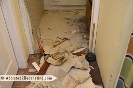 bathroom makeover removing old vinyl flooring