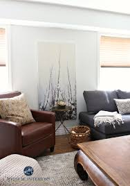family room accent chairs. sherwin williams creamy in family room. leather accent chair and gray sectional. kylie m interiors e-design online color consulting room chairs l