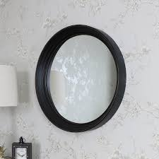 large black round wall mounted mirror