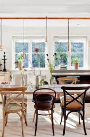 a cote in the stockholm archipelagos mismatched chairs dining room design dining rooms