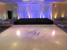 renaissance schaumburg nirvana ballroom white floor monogram and stage backdrop