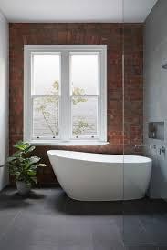 Bathtubs Idea, Oversized Bathtub Alcove Bathtub Red Brik Bathroom Wall  Black Tile Floor Modern Freestanding